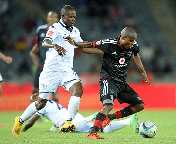 Thabo Matlaba  of Orlando Pirates is challenged by Papy Faty of Bidvest Wits  during the Absa Premiership match between Orlando Pirates and Bidvest Wits  on 21 October 2015 at Orlando Stadium Pic Sydney Mahlangu/ BackpagePix