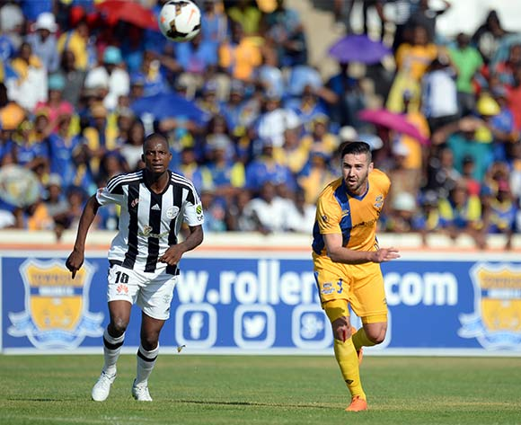 Carl Finnigan of Township Rollers and Kaelo Kgaswane of  Mochudi centre Chiefs during the beMobile Premiership match between Township Rollers and Mochudi Centre Chiefs at the national stadium in Gaborone on 25 October 2015.  Backpagepix/Monirul Bhuiyan