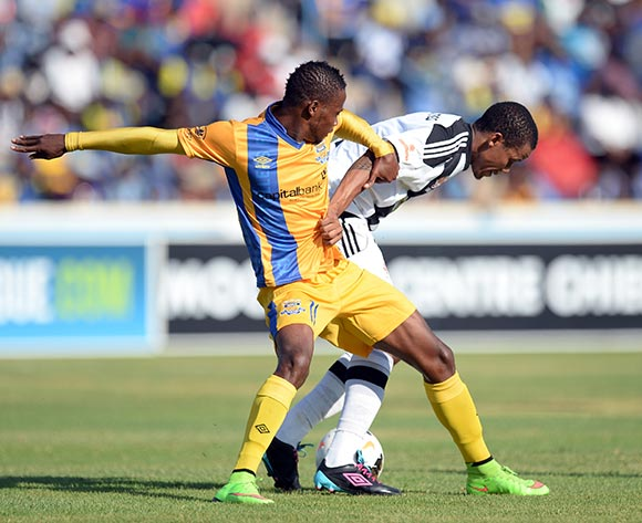 Segolame Boy of Township Rollers and Jackie Mothatego of Mochudi centre Chiefs during the beMobile Premiership match between Township Rollers and Mochudi Centre Chiefs at the national stadium in Gaborone on 25 October 2015.  Backpagepix/Monirul Bhuiyan