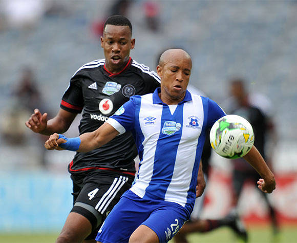 Kurt Lentjies of Maritzburg United challenged by Happy Jele of Orlando Pirates during the 2015 Telkom Knockout last 8 match between Orlando Pirates and Maritzburg United  at Orlando Stadium, Soweto on the 24 October 2015