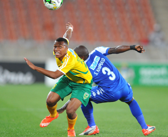 Thembela Sikhakhane of Golden Arrows challenged by Sibusiso Khumalo of Supersport United during the 2015 Telkom Knockout match between Supersport United and Golden Arrows at the Peter Mokaba Stadium in Polokwane, South Africa on October 24, 2015 ©Samuel Shivambu/BackpagePix