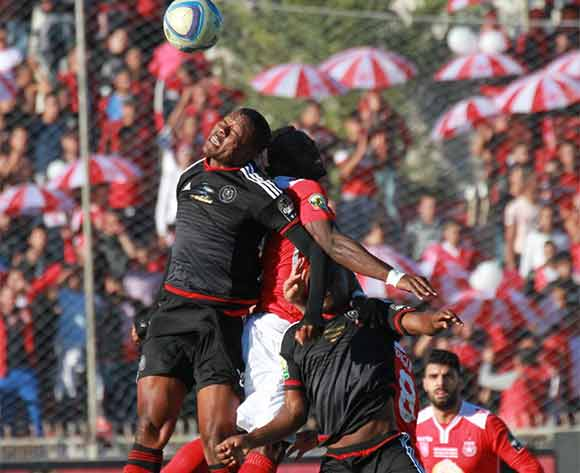 Thamsanqa Gabuza and Lehlogonolo Masalesa both of Orlando Pirates in an aerial battle with opposition players during the CAF Confederations Cup Final 2nd Leg match between Etoile Du Sahel and Orlando Pirates on 29 November 2015 at Olympic Stadium in Sousse/ BackpagePix