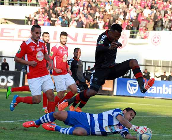 Etoile Du Sahel goalkeeper saves from advancing Siyabonga Sangweni of Orlando Pirates during the CAF Confederations Cup Final 2nd Leg match between Etoile Du Sahel and Orlando Pirates on 29 November 2015 at Olympic Stadium in Sousse/ BackpagePix