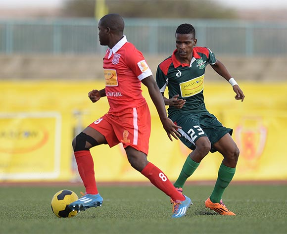 Alphonse Modisaotsile of Gaborone United and Abi Ramodiane of BDF XI during the Mascom Top8 quarter final match between Gaborone United and BDF XI at the Molepolole sports complex in Botswana on 1 November 2015. Back page pix/Mnirul Bhuiyan