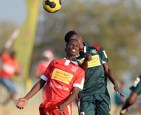 Katlego K Koobake of Gaborone United and Bonolo Phuduhudu of BDF XI during the Mascom Top8 quarter final match between Gaborone United and BDF XI at the Molepolole sports complex in Botswana on 1 November 2015.Back page pix/Mnirul Bhuiyan
