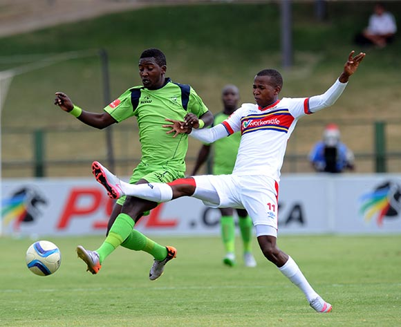 Masibusane Zongo of Platinum Stars is challenged by Thabo Mosadi of University of Pretoria during the Absa Premiership match between University of Pretoria and Platinum Stars  on 31 October 2015 at Tuks Stadium Pic Sydney Mahlangu/ BackpagePix