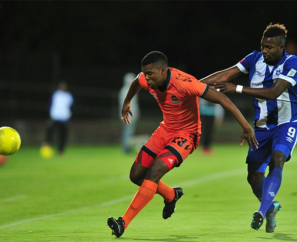 Tshepo Tema of Polokwane City battles with Yakubu Mohammed of Maritzburg United during the Absa Premiership 2015/16 match between Maritzburg United and Polokwane City at Harry Gwala Stadium, Pietermaritzburg on the 03 November 2015