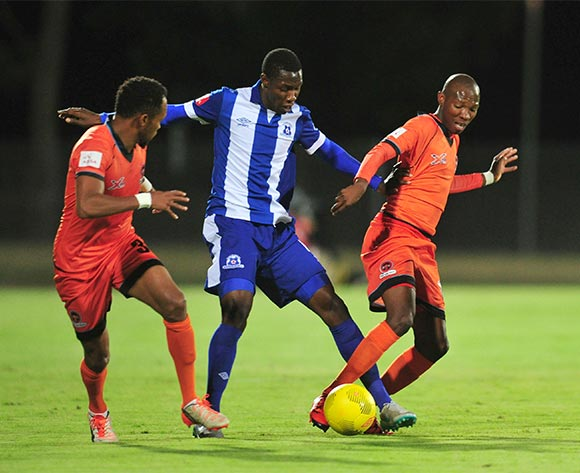 Jabulani Maluleke of Polokwane City battles with Evans Rusike of Maritzburg United during the Absa Premiership 2015/16 match between Maritzburg United and Polokwane City at Harry Gwala Stadium, Pietermaritzburg on the 03 November 2015