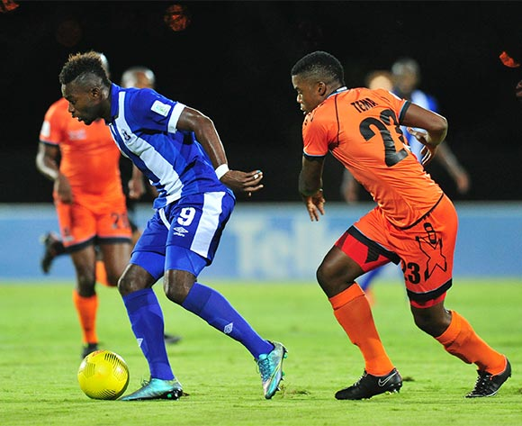 Yakubu Mohammed of Maritzburg United challenged by Tshepo Tema of Polokwane City during the Absa Premiership 2015/16 match between Maritzburg United and Polokwane City at Harry Gwala Stadium, Pietermaritzburg on the 03 November 2015