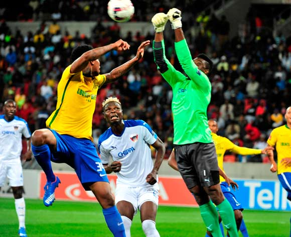 Daniel Akpeyi of Chippa United gets the ball away from Bongani Zungu of ~Mamelodi Sundowns watched by Aristide Bance of Chippa United during the Absa Premiership 2015/16 game between Chippa United and Mamelodi Sundowns at Nelson Mandela Bay Stadium, Port Elizabeth