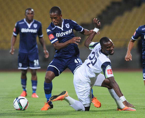 Robert Ngambi of Platinum Stars is tackled by Phumlani Ntshangase of Bidvest Wits   during the Absa Premiership match between Platinum Stars and Bidvest Wits  on 04 November 2015 at Royal Bafokeng Stadium Pic Sydney Mahlangu/ BackpagePix