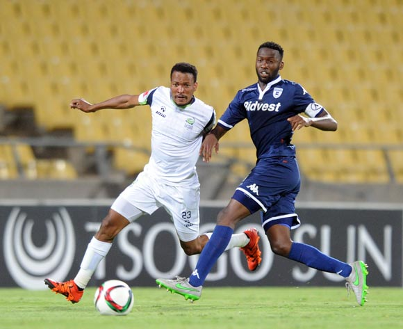 Tlou Segolela of Platinum Stars challenges Buhle Mkhwanazi of Bidvest Wits during the Absa Premiership match between Platinum Stars and Bidvest Wits  on 04 November 2015 at Royal Bafokeng Stadium Pic Sydney Mahlangu/ BackpagePix