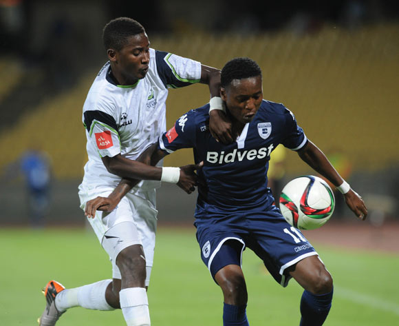 Masibusane Zongo of Platinum Stars challenges Elias Pelembe of Bidvest Wits during the Absa Premiership match between Platinum Stars and Bidvest Wits  on 04 November 2015 at Royal Bafokeng Stadium Pic Sydney Mahlangu/ BackpagePix