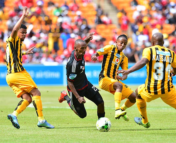 Thabo Rakhale of Orlando Pirates challenged by George Lebese (l), Hendrick Ekstein (c) and Willard Katsande of Kaizer Chiefs during the 2015 Telkom Knockout football match between Kaizer Chiefs and Orlando Pirates at Soccer City in Johannesburg, South Africa on 07 November 2015 ©Gavin Barker/BackpagePix