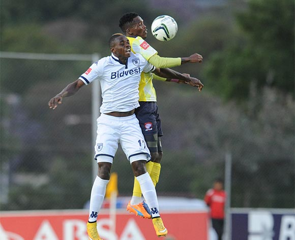 Papy Faty of Bidvest Wits is challenged by Thabang Monare of Jomo Cosmos  during the Absa Premiership  match between Bidvest Wits and Jomo Cosmoson 08 November 2015 at Bidvest Stadium Pic Sydney Mahlangu/ BackpagePix