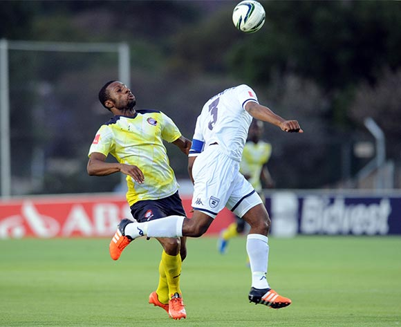 Thulani Hlatshwayo of Bidvest Wits clears the ball ahead of  Brice Aka of Jomo Cosmos  during the Absa Premiership  match between Bidvest Wits and Jomo Cosmoson 08 November 2015 at Bidvest Stadium Pic Sydney Mahlangu/ BackpagePix