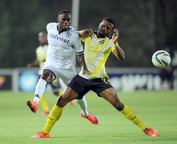 Onismor Bhasera of Bidvest Wits is challenged by Brice Aka of Jomo Cosmos  during the Absa Premiership  match between Bidvest Wits and Jomo Cosmoson 08 November 2015 at Bidvest Stadium Pic Sydney Mahlangu/ BackpagePix