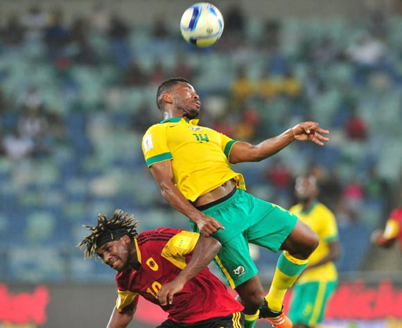 Menga Dolly Domingos of Angola battles with Thulani Hlatshwayo of South Africa during the 2018 Russia World Cup Qualifier match between South Africa and Angola at Moses Mabhida Stadium, Durban on the 17 November 2015 ©Muzi Ntombela/BackpagePix