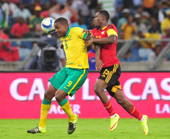 Thamsanqa Gabuza of South Africa challenged by Bartolomeu J. Quissanga of Angola during the 2018 Russia World Cup Qualifier match between South Africa and Angola at Moses Mabhida Stadium, Durban on the 17 November 2015 ©Muzi Ntombela/BackpagePix
