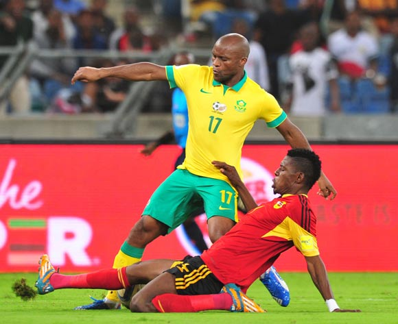 Tokelo Rantie of South Africa tackled by Fabricio Mafuta of Angola during the 2018 Russia World Cup Qualifier match between South Africa and Angola at Moses Mabhida Stadium, Durban on the 17 November 2015 ©Muzi Ntombela/BackpagePix