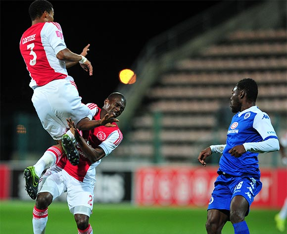 Abel Mabaso and Rivaldo Coetzee of Ajax Cape Town collide as Dove Wome of Supersport United looks on during the Absa Premiership 2015/16 game between Ajax Cape Town and Supersport United at Athlone Stadium, Cape Town on 21 November 2015 ©Ryan Wilkisky/BackpagePix