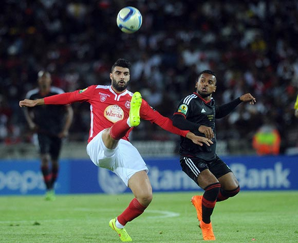 Zied `Boughattas of Etoile Du Sahel challenges Kermit Erasmus of Orlando Pirates during the CAF Confederations Cup Final 1st Leg match between Orlando Pirates and Etoile Du Sahel  on 21 November 2015 at Orlando StadiumPic Sydney Mahlangu/ BackpagePix