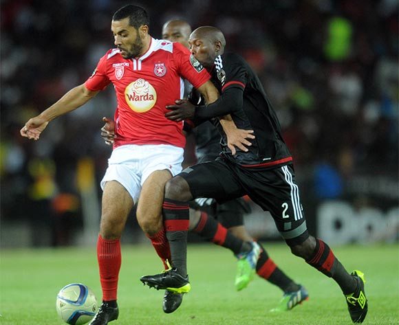 Ayanda Gcaba of Orlando Pirates tackles  Alaya Brigui of Etoile Du Sahel  during the CAF Confederations Cup Final 1st Leg match between Orlando Pirates and Etoile Du Sahel  on 21 November 2015 at Orlando StadiumPic Sydney Mahlangu/ BackpagePix