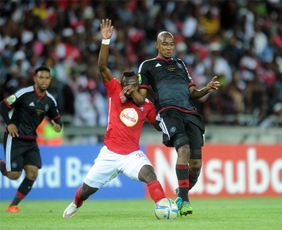 Franck Kom of Etoile Du Sahel challenges Lehlogonolo Masalesa of Orlando Pirates during the CAF Confederations Cup Final 1st Leg match between Orlando Pirates and Etoile Du Sahel  on 21 November 2015 at Orlando StadiumPic Sydney Mahlangu/ BackpagePix