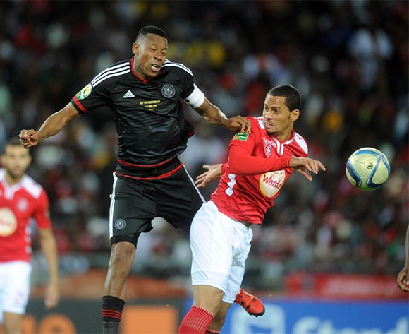 Happy Jele of Orlando Pirates challenges Bagdad Bounedjah of Etoile Du Sahel  during the CAF Confederations Cup Final 1st Leg match between Orlando Pirates and Etoile Du Sahel  on 21 November 2015 at Orlando StadiumPic Sydney Mahlangu/ BackpagePix