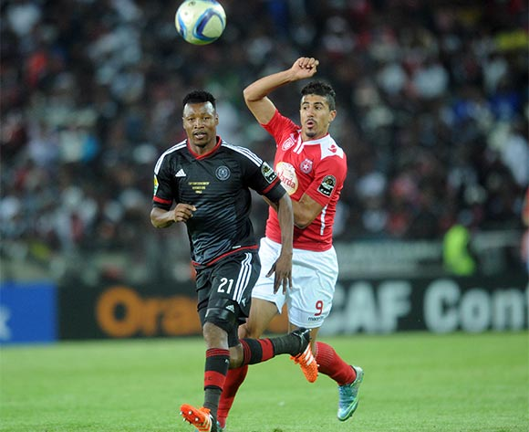 Siyabonga Sangweni of Orlando Pirates challenges Bagdad Bounedjah of Etoile Du Sahel  during the CAF Confederations Cup Final 1st Leg match between Orlando Pirates and Etoile Du Sahel  on 21 November 2015 at Orlando StadiumPic Sydney Mahlangu/ BackpagePix