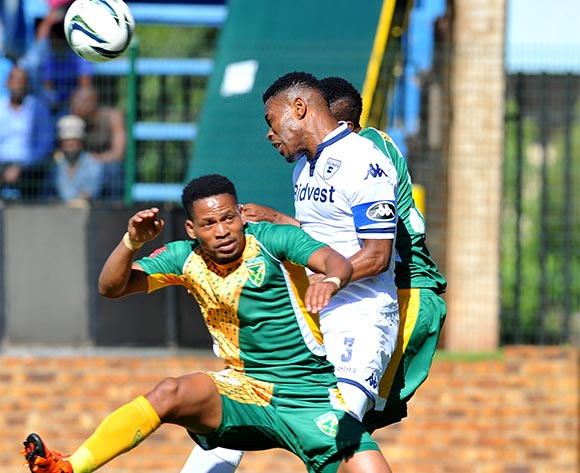 Thulani Hlatshwayo of Bidvest Wits challenged by Edgar Manaka of Golden Arrows during the Absa Premiership match between Bidvest Wits and Golden Arrows at the Bidvest Stadium in Johannesburg, South Africa on November 21, 2015 ©Samuel Shivambu/BackpagePix