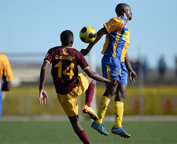 Lawrence Majawa of Township Roller football club and Tapiwa Gadibolae of Police XI during the Mascom Top8 match between Township rollers and Police XI at the Molepolole sports complex in Botswana on 22 November 2015. Pic:Monirul Bhuiyan/Backpage pix