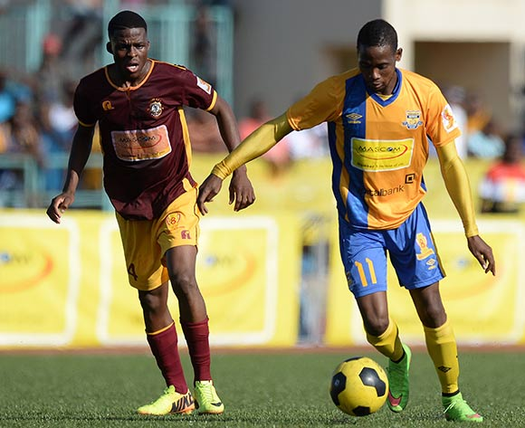 Segolame Boy of Township Roller football club and Tapiwa Gadibolae of Police XI during the Mascom Top8 match between Township rollers and Police XI at the Molepolole sports complex in Botswana on 22 November 2015. Pic:Monirul Bhuiyan/Backpage pix