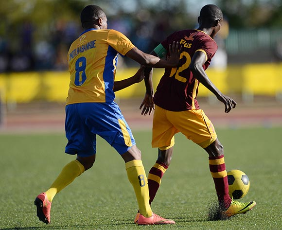 Tshepo Mothlabankwe of Township Roller football club and Betsho Pius of Police XI during the Mascom Top8 match between Township rollers and Police XI at the Molepolole sports complex in Botswana on 22 November 2015. Pic:Monirul Bhuiyan/Backpage pix