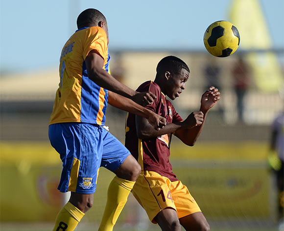 Tshepo Mothlabankwe of Township Roller football club and Tapiwa Gadibolae of Police XI during the Mascom Top8 match between Township rollers and Police XI at the Molepolole sports complex in Botswana on 22 November 2015. Pic:Monirul Bhuiyan/Backpage pix