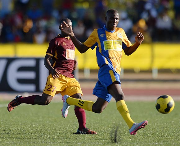 Gofaone Tiro of Township Roller football club and Otlaadisa Manyika of Police XI during the Mascom Top8 match between Township rollers and Police XI at the Molepolole sports complex in Botswana on 22 November 2015. Pic:Monirul Bhuiyan/Backpage pix