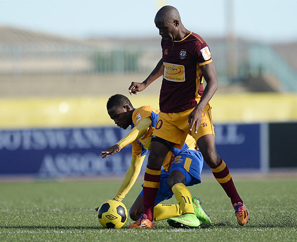 Segolame Boy of Township Roller football club and of Louis Minjale of Police XI during the Mascom Top8 match between Township rollers and Police XI at the Molepolole sports complex in Botswana on 22 November 2015. Pic:Monirul Bhuiyan/Backpage pix