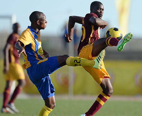 Maano Ditshupo of Township Roller football club and Louis Minjale of Police XI during the Mascom Top8 match between Township rollers and Police XI at the Molepolole sports complex in Botswana on 22 November 2015. Pic:Monirul Bhuiyan/Backpage pix