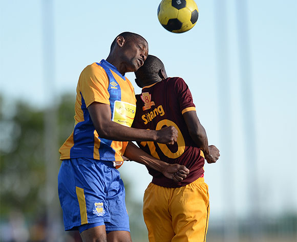 Muggy Motlhabankwe of Township Roller football club and Ogomoditse Sitang of Police XI during the Mascom Top8 match between Township rollers and Police XI at the Molepolole sports complex in Botswana on 22 November 2015. Pic:Monirul Bhuiyan/Backpage pix