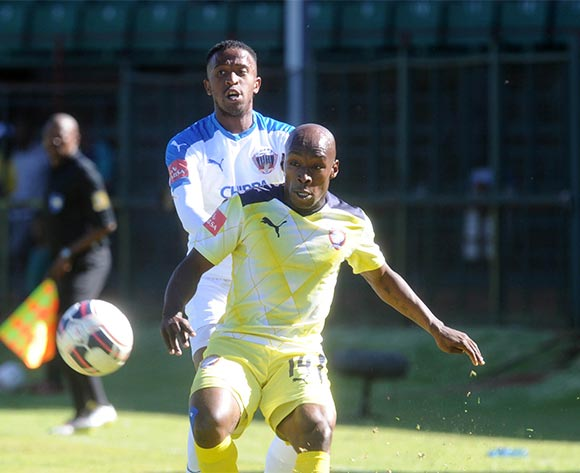 Sipho Mngomezulu of Jomo Cosmos challenges William Twala of Chippa United during the Absa Premiership match between Jomo Cosmos and Chippa United on 22 November 2015 at Olen Park Pic Sydney Mahlangu/ BackpagePix