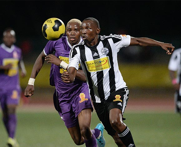 Onalethata Tshekiso of Mochudi Centre Chiefs football club and Lebogang Ditsele of Gilport Lions during the Mascom Top8 match between Mochudi Centre Chiefs  and Gilport Lions  at the Molepolole sports complex in Botswana on 23 November 2015. Pic:Monirul Bhuiyan/Backpage pix