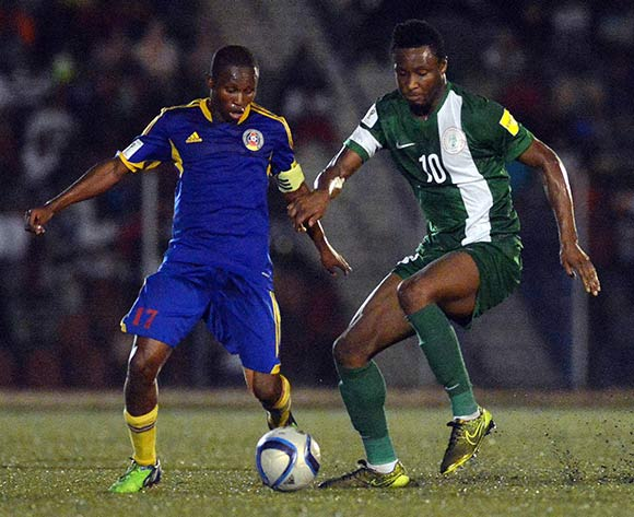 Mikel (right) for Nigeria against Tsabedze Tony of Swaziland last year