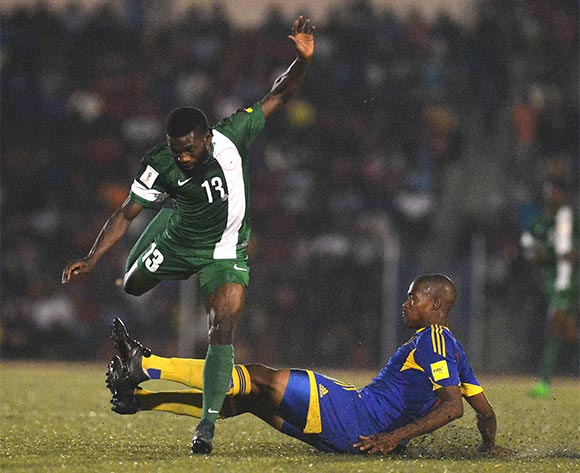Rabiu Ibrahim of Nigeria evade tackle from Ndlove Njabulo of Swaziland during  the Russia 2018 World Cuo qualifier  match between Swanziland v Nigeria  on the 13th of November 2015 at  Somhlolo National  Stadium,Swaziland © Kabiru Abubakar/Backpagepix