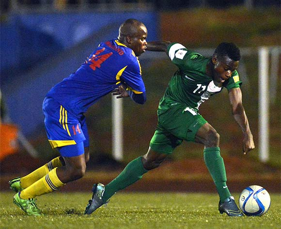 Moses Simon of Nigeria beat Dlamini Machawe of Swaziland during  the Russia 2018 World Cuo qualifier  match between Swanziland v Nigeria  on the 13th of November 2015 at  Somhlolo National  Stadium,Swaziland © Kabiru Abubakar/Backpagepix