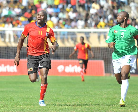 Akakpo Serge of Togo challenges Geofrey Massa of Uganda Cranes during the return leg of the 2018 Fifa World Cup Russia Qualifiers on 15 November 2015 at Mandela Stadium, Namboole, Kampala. ©Ismail Kezaala/BackpagePix