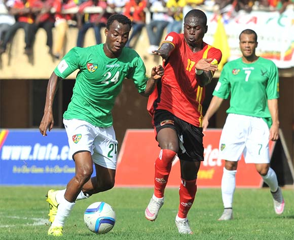 Farouk Miya of Uganda Cranes challenges Eninful Akoete of Togo during the return leg of the 2018 Fifa World Cup Russia Qualifiers on 15 November 2015 at Mandela Stadium, Namboole, Kampala. ©Ismail Kezaala/BackpagePix