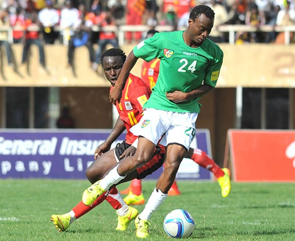 Tonny Mawejje of Uganda Cranes challenges Eninful Akoete of Togo during the return leg of the 2018 Fifa World Cup Russia Qualifiers on 15 November 2015 at Mandela Stadium, Namboole, Kampala. ©Ismail Kezaala/BackpagePix