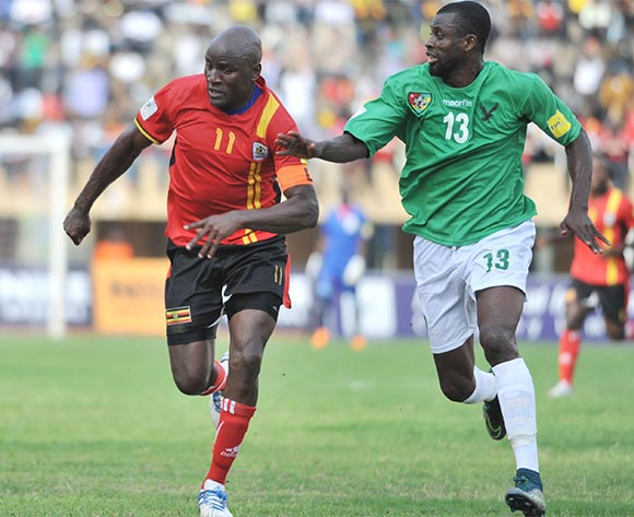 Ouro Akoriko of Togo challenge Geofrey Massa of Uganda Cranes during the return leg of the 2018 Fifa World Cup Russia Qualifiers on 15 November 2015 at Mandela Stadium, Namboole, Kampala. ©Ismail Kezaala/BackpagePix