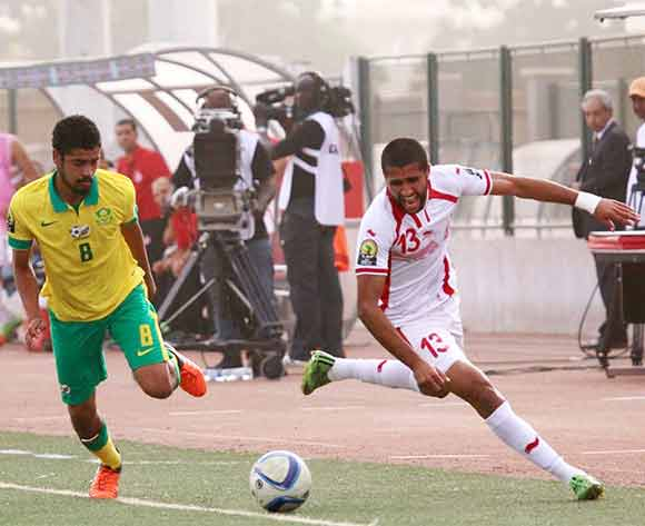 Abbubaker Mobara of South Africa challenges Ali Abdi of Tunisia during the U23 African Cup of Nations match between South Africa and Tunisia at Caroline Faye Stadium,Mbour on 04th December 2015 ©/BackpagePix