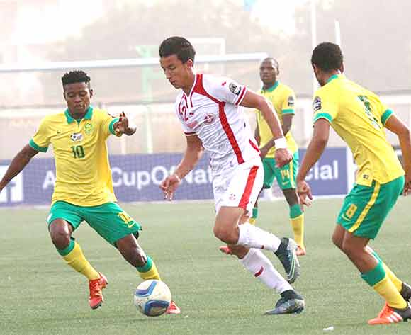 Menzi Masuku and Abbubaker Mobara both of South Africa challenges Wajdi Kechrida of Tunisia during the U23 African Cup of Nations match between South Africa and Tunisia at Caroline Faye Stadium,Mbour on 04th December 2015 ©/BackpagePix